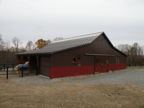 horse barn with run in sheds